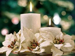 white candles and poinsettias table arrangement for christmas