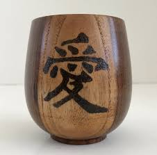 bamboo cup with wood burned chinese calender symbol for love