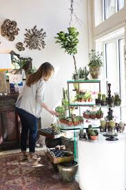 home design store and gifts store owner waters succulents home and gift shop in greenville