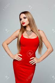 gold necklace dress images Portrait of beautiful fashionable woman in a bright red dress jpg