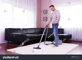vacuum the carpet he cleaned carpet vacuum cleaner stock photo 93715252 shutterstock