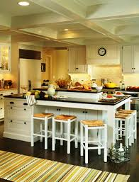 kitchen white kitchen table black tile floor neat kitchen island