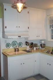 vintage kitchen cabinet makeover creative ways to update 1950 s plywood cabinets with the