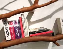 the images of top 5 creative bookshelves using branch of dead tree