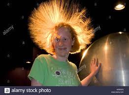 hair generator static electricity in a girls hair from a van de graaff generator