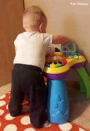 baby standing table toy 5 ways to promote pulling to stand pink oatmeal