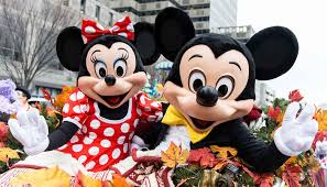 disney mascot arranges two orphaned to meet mickey in disney