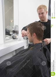 man getting an haircut from hairdresser royalty free stock image