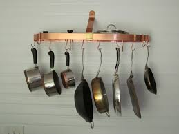 adorable hanging circle pot rack design made from copper material