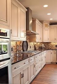 white kitchen cabinets with black granite countertops images