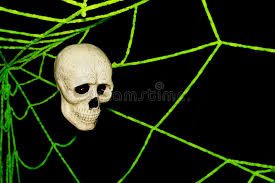 skull and spider webs on wall ghost on stock image