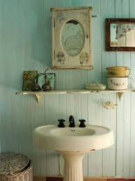 pedestal sink with a small mirror for the bathroom decor