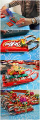 10 tutorials to diy christmas gifts candy sleigh diy christmas