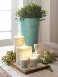 winter home decorating ideas with candles and bird statue and vase