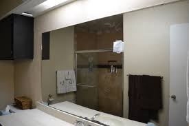bathroom cabinets framing a mirror framed bathroom mirror