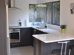 simple narrow u shape kitchen features white wooden kitchen