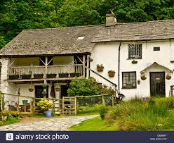 House Lots Nice House In Lake District With A Lots Of Flower Pots Stock Photo