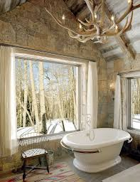 exquisite and inspired bathrooms with stone walls rustic bathroom with stone wall vintage bathtub and antler chandelier design jlf