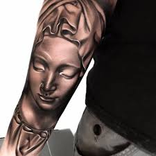 close eyes saint mary mother back lower arm tattoo design by levi