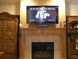 fireplace mantels with tv above fireplace mounting a tv over a