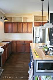 Do Kitchen Cabinets Go In Before Flooring Building Cabinets Up To The Ceiling From Thrifty Decor