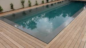 Teak Floor Tiles Outdoors by Teak Decking Installation Around Swimming Pool With Hidden