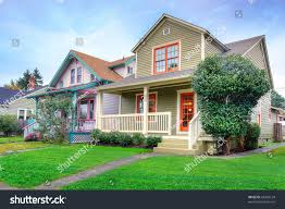 cute craftsman style small green house stock photo 68435134