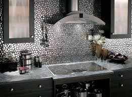 The Kitchen Backsplash Combine Art With Functionality - Metal kitchen backsplash