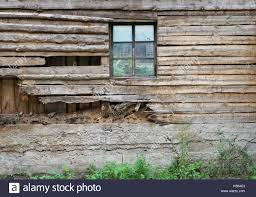 the rotten wooden wall of a barn with a simple abandoned
