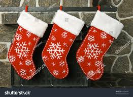 christmas stockings on fireplace mantel stock photo 19224070