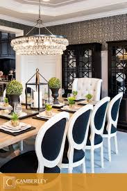 a supremely elegant crystal chandelier hangs above the hamilton model s formal dining room nature inspired centerpieces decorate the lightly stained wood