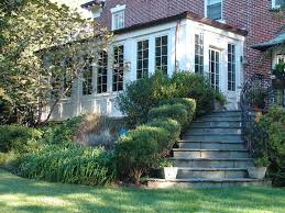 sunroom decorating ideas for a traditional exterior with a wall