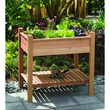 wood raised planter box with storage for small backyard garden
