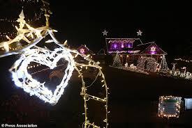 heart shaped christmas lights family s christmas lights spectacular raises cash for daily