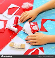 child made a felt christmas tree house decoration child show
