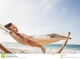 man sleeping in hammock stock photo image 68248320