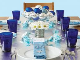 table centerpiece decoration with blue glass and blue napkins plus