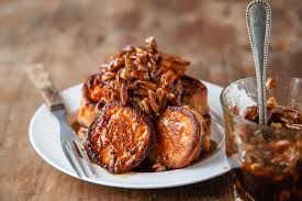 melting sweet potatoes roasted with maple pecan sauce