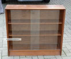 Bookcase With Glass Door Rectangle Brown Wooden Bookshelves With Sliding Glass Door On Grey