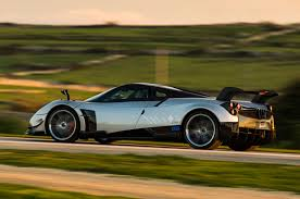 pagani back watch a pagani huayra bc spit blue flames