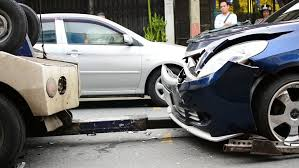 crashed car after accident stand at road side at background of