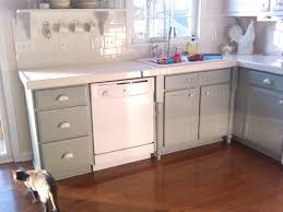 gray kitchen cabinets with black counter grey metal chrome single