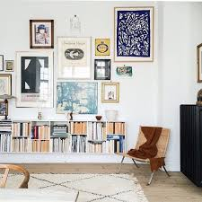 Interior Design Books For Beginners by Gallery Wall And Bookshelf In Modern Bohemian Style Living Room