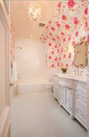 simple white kids bathroom decor with pink white flower wallpaper
