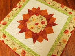 quilted square table toppers quilted square table topper with orange yellow and red flowers