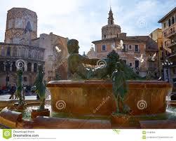 valencia plaza de la virgen sq and neptune statue stock photo