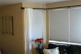 how to hang curtains in a bay window image of ideal corner curtain rod hanging curtains