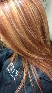 brunette hairstyle with lots of hilights for over 50 copper red hair color with golden blonde highlights