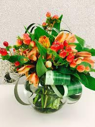 orange spice color rusty spice color theme mini flower arrangement in circle vase using