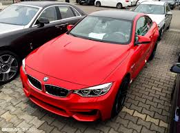 red bmw m4 individual m4 in ferrari red color